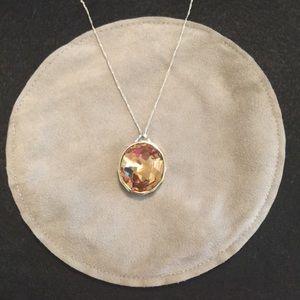 Oval light brown crystal pendant